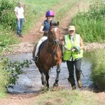 Gwenda Bassett leading Macey through the ford - Camp 2013
